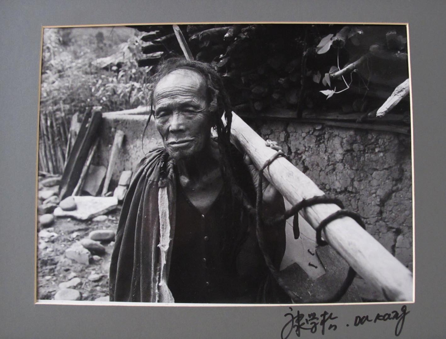 DA KANG. - Miao. Older man with wooden tool.